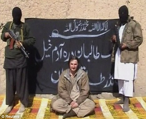 Pakistani Taliban fighters under the command of Qari Hussain Mehsud stand alongside kidnapped Polish geologist Piotr Stanczak minutes before he was beheaded. Reuters photo.
