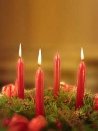 advent wreath with three lit candles
